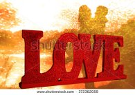stock-photo-love-greeting-card-with-a-romantic-couple-in-the-background-with-sunset-372362059